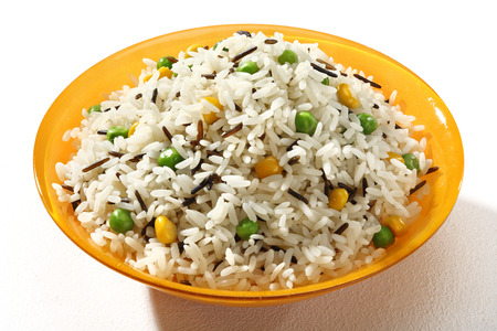 rice plate: Dish of black & white rice in an orange plate  on white background. Close up, high resolution product.