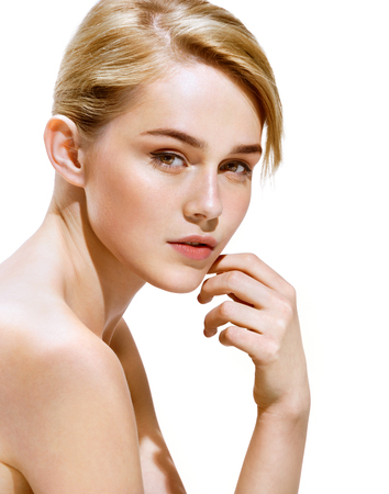 Charming young woman with perfect make up. Close up of an attractive girl of European appearance on white background. Youth and skin care concept