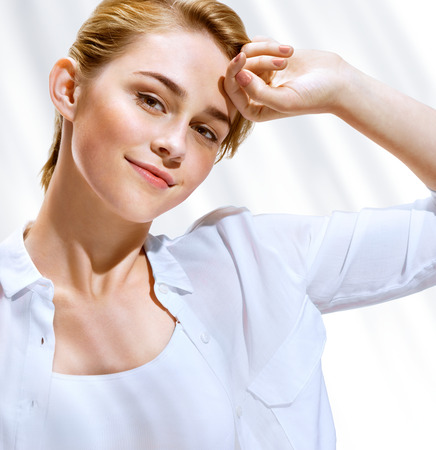 Beautiful sensual blonde girl in white blouse on hot sunny day. Youth and skin care concept. Stock Photo