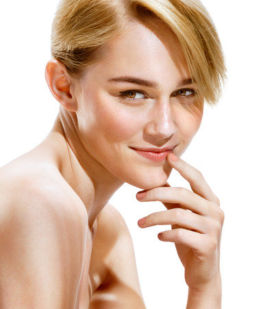 lips close up: Young smiling woman touching her lips. Close up of an attractive girl of European appearance on white background. Beauty & Skin Care Concept.