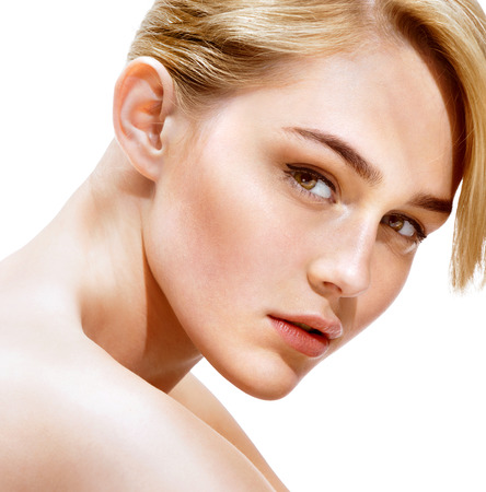 glowing skin: Beautiful woman face. Close up of an attractive girl of European appearance on white background. Youth and Skin Care Concept. Stock Photo