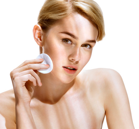toner: Young woman cares for face skin relaxation. Close up of an attractive girl of European appearance on white background. Beauty & Spa Concept.