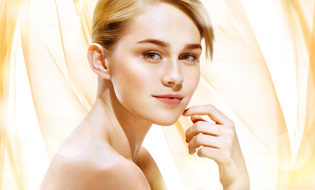girl  care: Attractive blonde girl on beige background. Youth and Skin Care Concept. Stock Photo