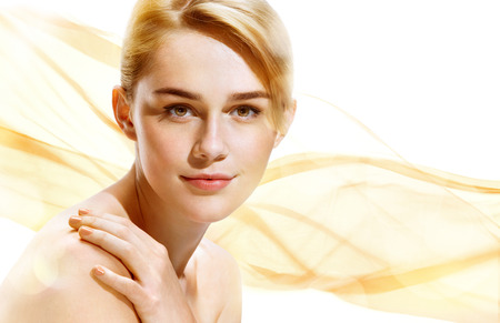 Beautiful Girl face on beige background. Perfect skin. Beauty & Spa Concept.