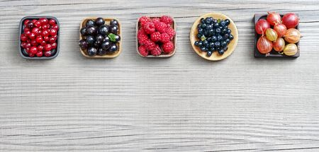 blueberry jam: Set of different berries on wooden background. Copy space for your text. Top view, high resolution product. Stock Photo
