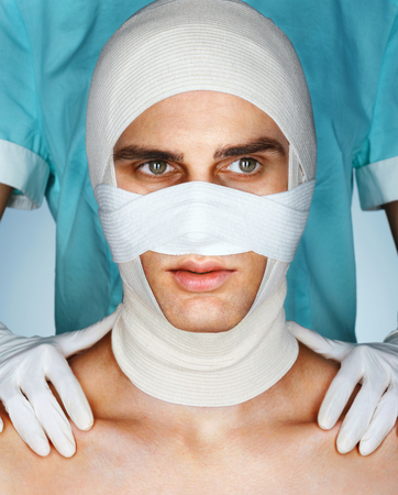 Mens face in medical bandage after beauty Plastic Surgery. Beauty concept