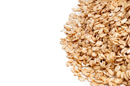 lose up: Golden oat flakes on white background. Close up, top view, high resolution product