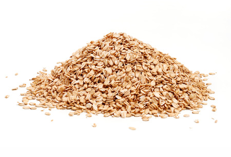 heap up: Heap golden oat flakes isolated on white background. Close up, high resolution product. Stock Photo