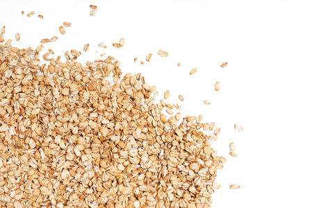 scattered on white background: Oat flakes scattered on white background. Copy space, high resolution product Stock Photo