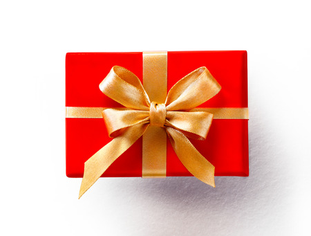 Red gift with golden bow on white background. Close up. Top view. High resolution product, top view Archivio Fotografico