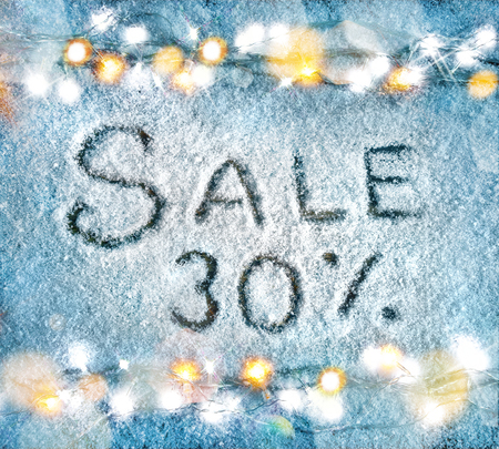 pct: Sale 30 percent off. Christmas snowy background with garland. Top View. Merry Christmas and Happy New Year discount!!