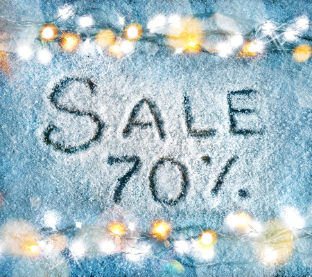 pct: Sale 70 percent off on snow background. Merry Christmas and Happy New Year discount!! Top view.