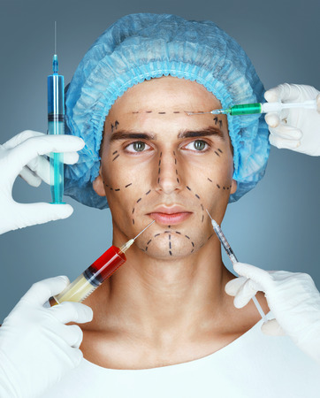 Man in medical hat and beauticians hands with syringes making botox injection in his face. Rejuvenation therapy concept.