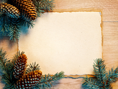 january 1: Christmas card with fir branches, pinecones on table. Merry Christmas and Happy New Year!! Top view.