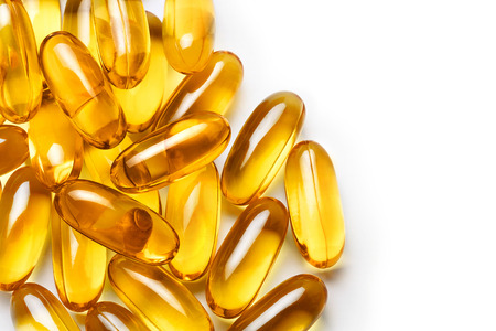 Pile of capsules Omega 3 on white background. Close up, top view, high resolution product. Archivio Fotografico