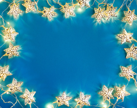 high quality: Blue background with garland. Top View. Merry Christmas and Happy New Year!!