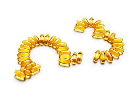 Omega 3 capsules forming symbols, isolated on white background. Copy space, high resolution product. Health care concept