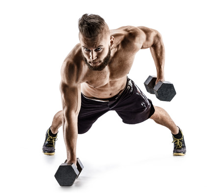 Handsome man doing  exercise with dumbbells. Photo of muscular man isolated on white background. Strength and motivation.