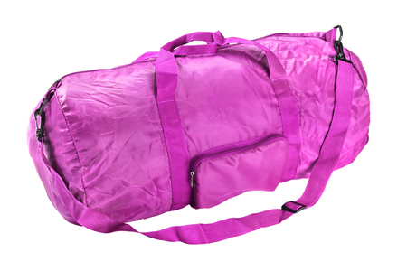 Road sports bag pink color. Studio photography handbag isolated on white background. Close up.