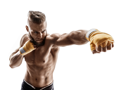 Sporty man throwing a fierce and powerful punch. Photo of muscular man isolated on white background. Strength and motivation