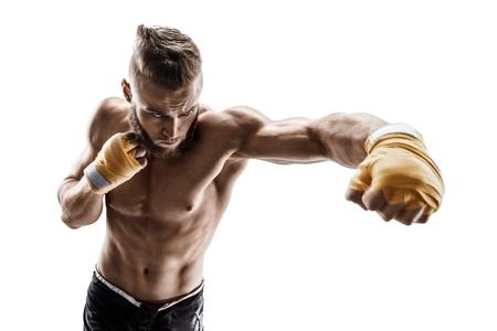 防衛: Muscular man throwing a fierce and powerful punch. Photo of sporty man isolated on white background. Strength and motivation