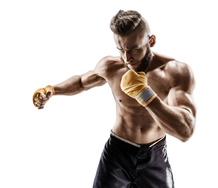 Boxer makes  a long side kick - swing. Photo of muscular man on white background. Strength and motivation Stock Photo