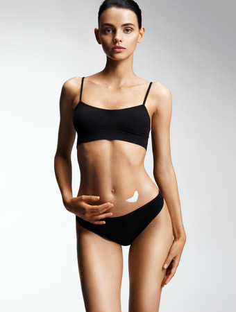 Perfect slim toned young body of the girl. Photo of attractive woman with perfect skin. Skin care concept Stock Photo