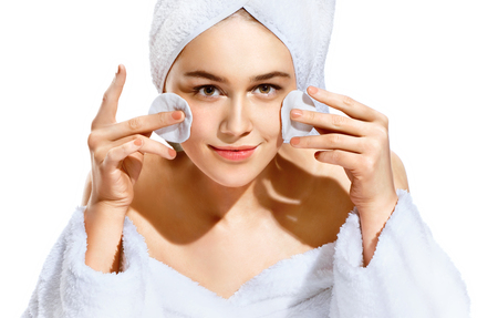 relaxion: Woman using cotton pad. Portrait of smiling beautiful woman cleaning skin by cotton pad. Skincare concept