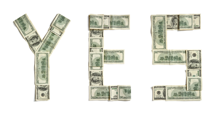 Word YES made of dollars. Photography of money made word - on white background. Top view. High resolution product