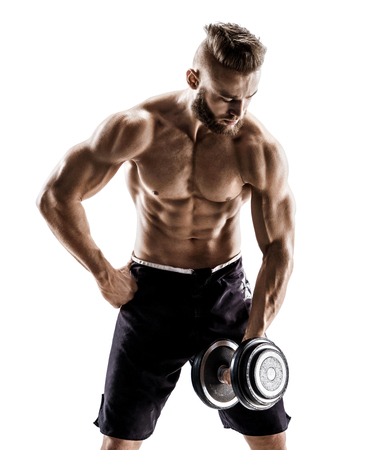 Young male doing exercises with dumbbells at biceps. Photo of muscular male with naked torso on white background. Strength and motivation