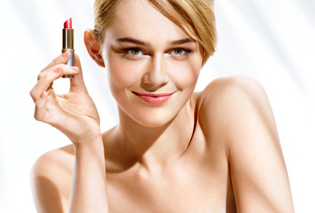 Gorgeous blonde woman with lipstick on white background. Youth and skin care concept Stock Photo