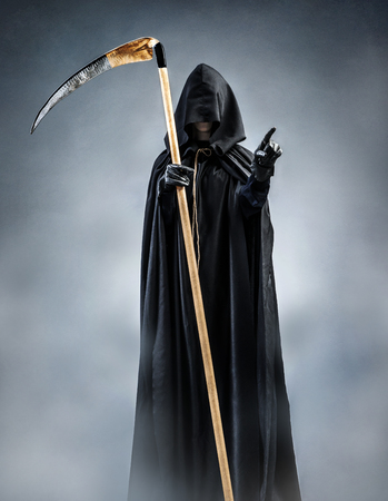 Grim Reaper points at you. Photo of silhouette grim reaper with pointing finger. Death Banco de Imagens - 78509151