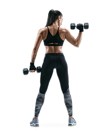 Strong woman working out with dumbbells, flexing her arm. Photo of sporty woman in sportswear on white background. Rear view. Full length