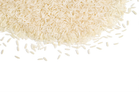 Parboiled rice scattered on white background. Copy space for your text. Top view, high resolution product. Healthy food concept Stock Photo