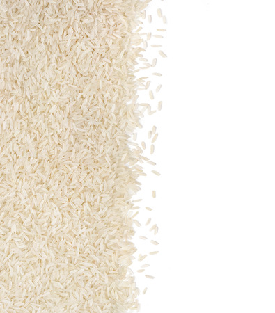 Parboiled rice on white background. Copy space for your text. Top view, high resolution product. Healthy food concept