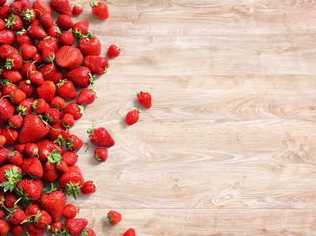 Healthy strawberry on wooden background. Fruits diet concept. Copy space. Top view, high resolution product