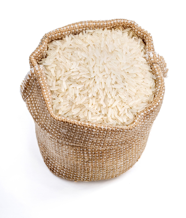 Burlap sack filled parboiled rice isolated on white background. Healthy food. Close up, top view, high resolution product