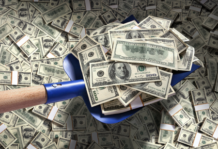 Money with shovel  studio photography of American moneys of hundred dollar Stock Photo