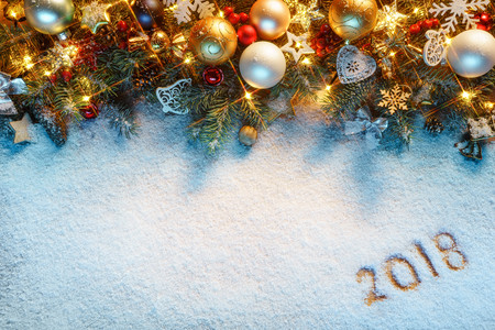 Christmas fir tree with decoration on snowy background. Merry Christmas and Happy New Year!! Top view. High resolution product Фото со стока