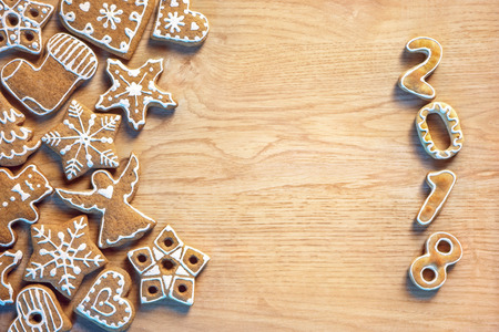 Merry Christmas and Happy new year! Delicious cookies on wooden background. Top view. High resolution product