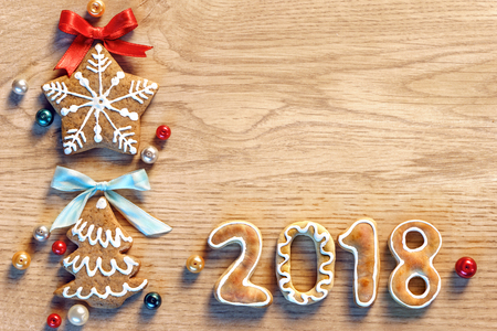 Gingerbread cookies on wooden table. Merry Christmas and Happy New Year 2018! Close up, top view. High resolution product Stock Photo