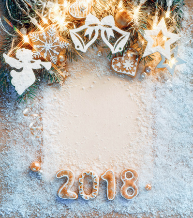Christmas card with cookies and Christmas toys on snow. Merry Christmas and Happy New Year!! Top View. High resolution product Stock Photo