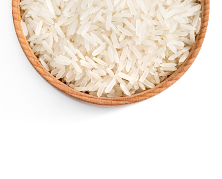Close up of wooden bowl filled parboiled rice on white background. Healthy food. Top view, high resolution product Stock Photo