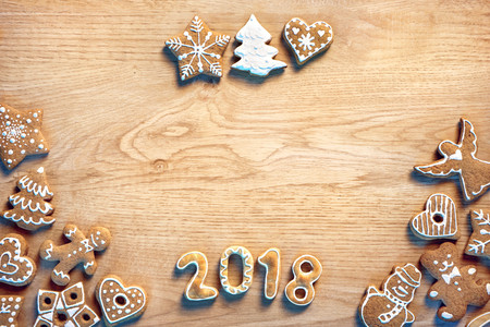 Merry Christmas and Happy new year! Homemade cookies on wooden background. Top view. High resolution product