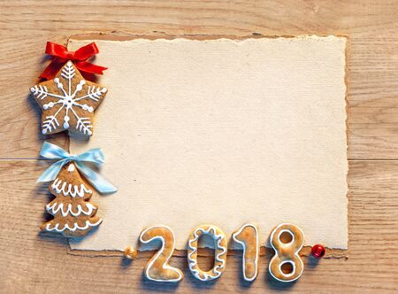 Christmas card with gingerbread cookies, 2018. Merry Christmas and Happy New Year!! Copy space for your text. Top view. High resolution product