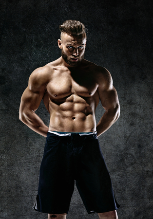 Sporty muscular man shirtless. Photo of man with perfect body after training. Strength and motivation Stock Photo