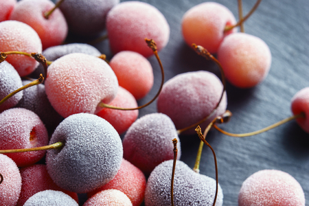 Frozen cherry on black slate. Close up. Top view. High resolution product. Stock Photo