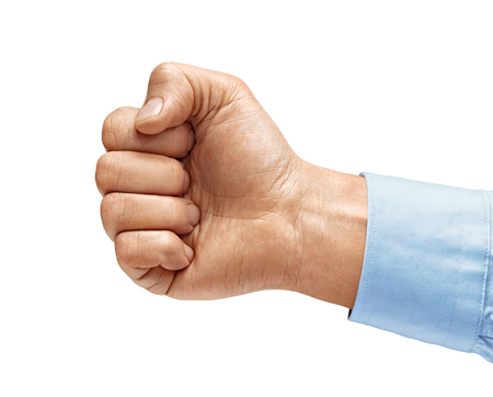 Mans hand in shirt with closed fist, isolated on white background. High resolution product. Close up