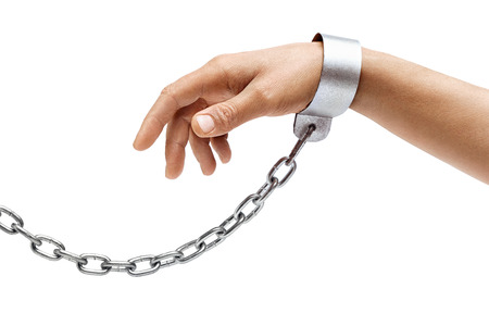 Mans hand in chains isolated on white background. Close up, concept against violence Stock Photo