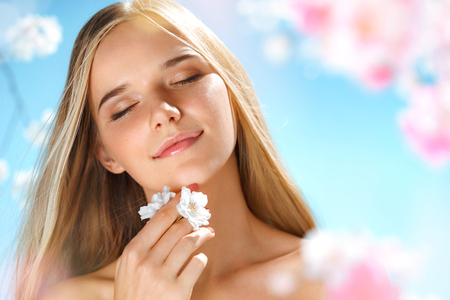 Sensual young girl with natural makeup. Youth and skin care. Spring.